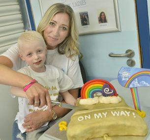 oscar boy with mum cake