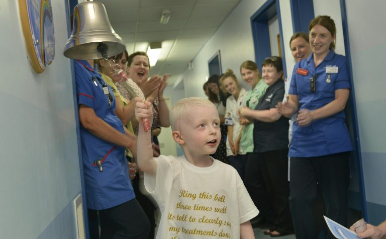 Oscar rings the end of treatment bell