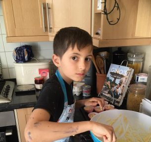 Boy in apron and mixing bowl