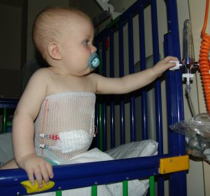 baby in a cot in hospital