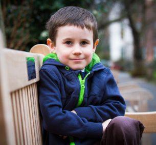 Luke sitting in a bench