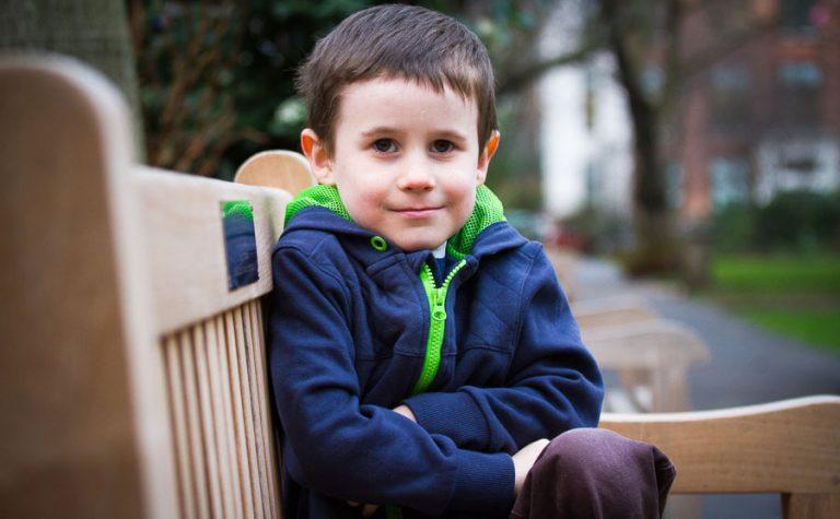 Luke sitting on a bench