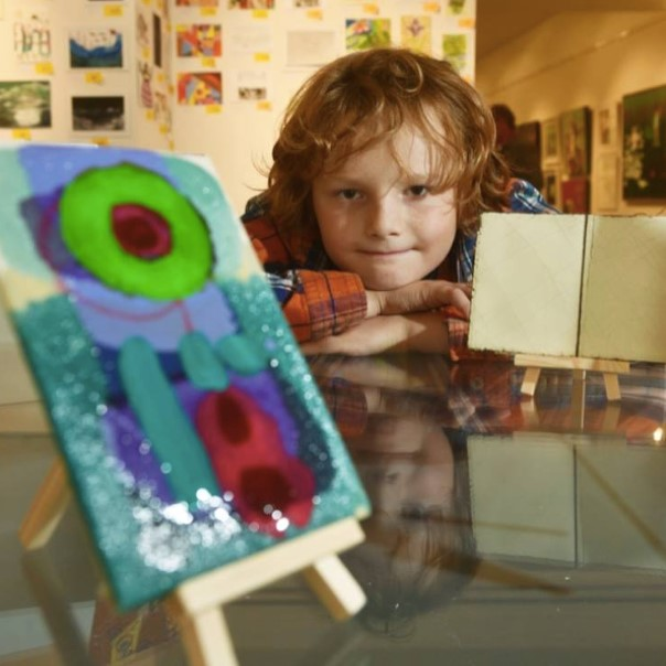 Henry boy with artwork