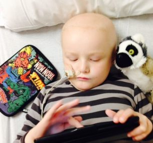 Henry boy with pencil case and teddy in bed