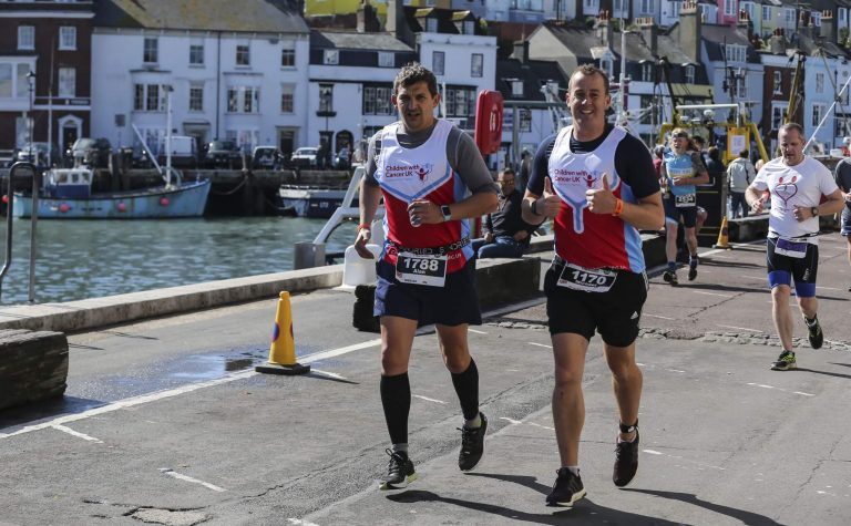 Children with Cancer UK runners participating in Ironman UK