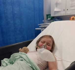 Girl in hospital bed
