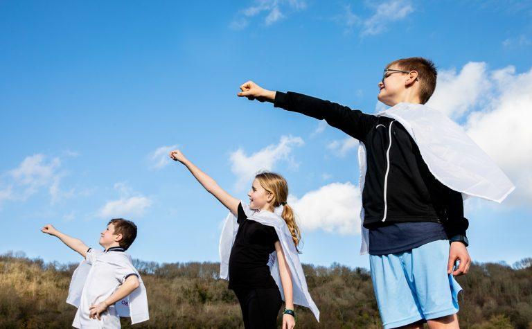4 children in their superhero poses