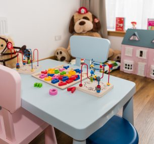 Child's table and chairs and toys