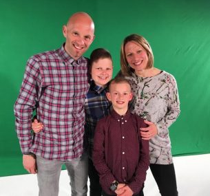 Family in front of green screen