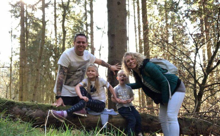 family sitting on tree