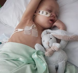 boy in hospital bed with bunny