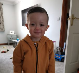 boy in orange hoodie
