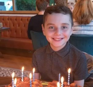liam boy with birthday cake with candles