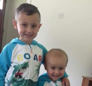 boys in matching jumper