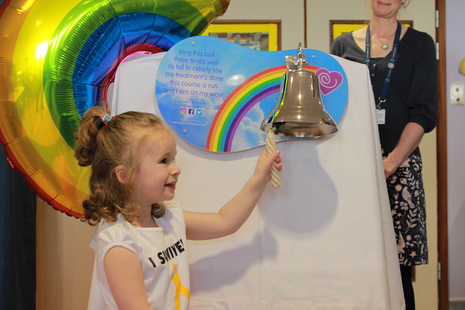 Bella rings the end of treatment bell