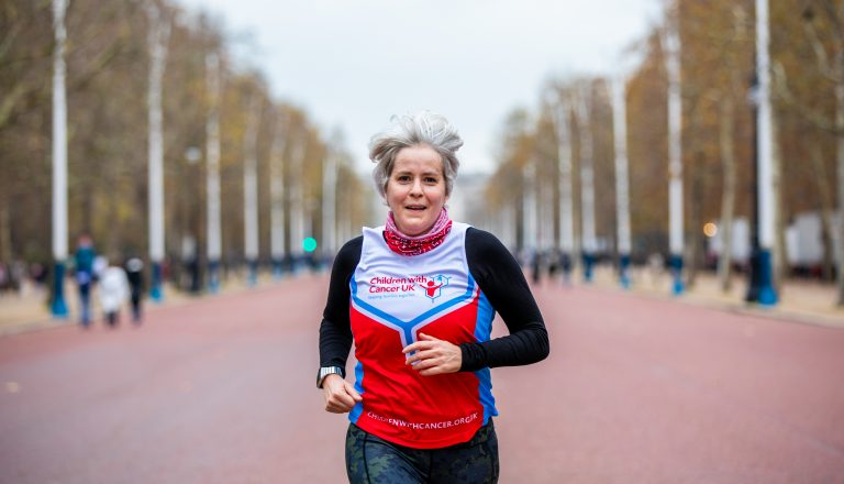 woman running in london marathon for children with cancer uk