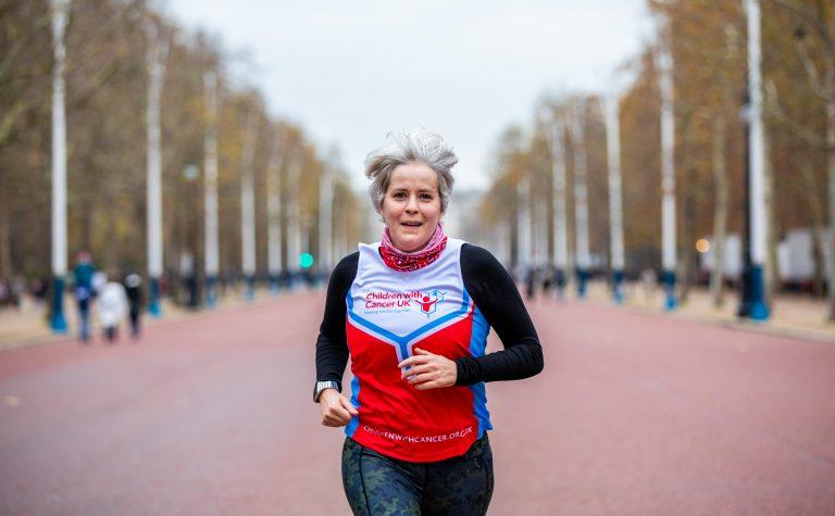 woman running in london marathon for children with cancer uk