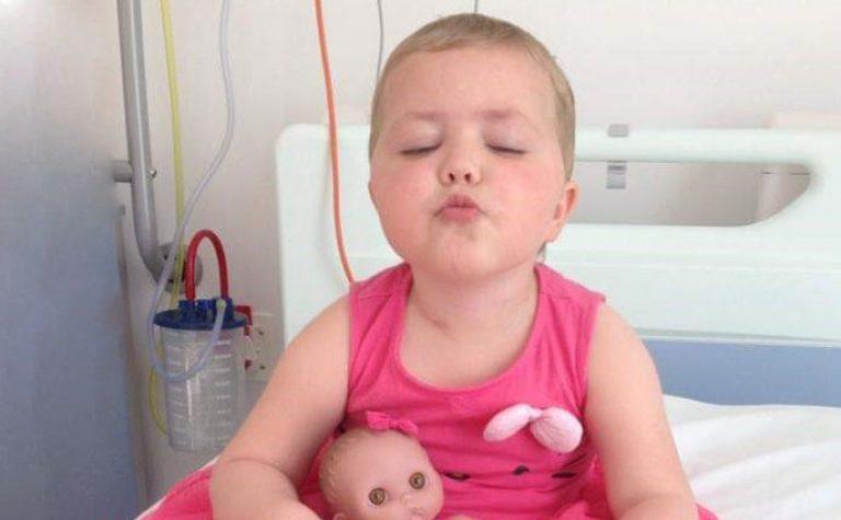 girl in pink dress in hospital