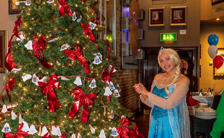 Elsa at the Christmas tree at the Manchester Christmas party