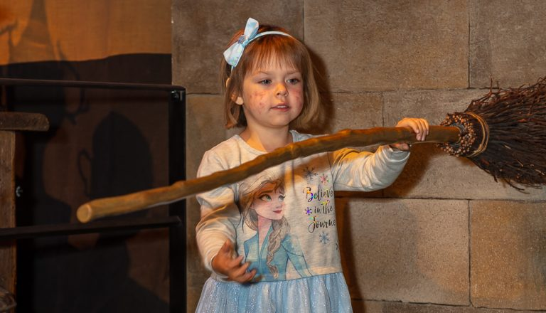 Sophia Bird with broomstick at Warner Bros studio tour