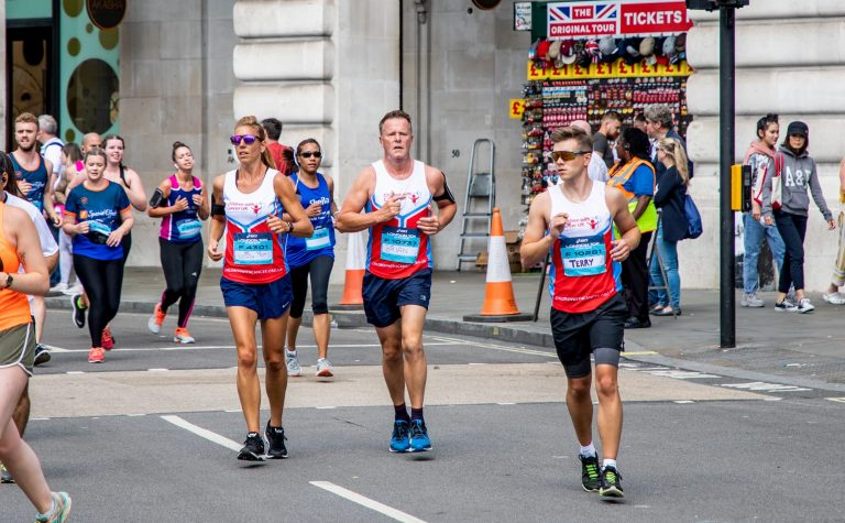 three runners running in london street ASICS 10k