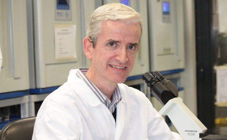 Owen Williams researcher in white lab coat
