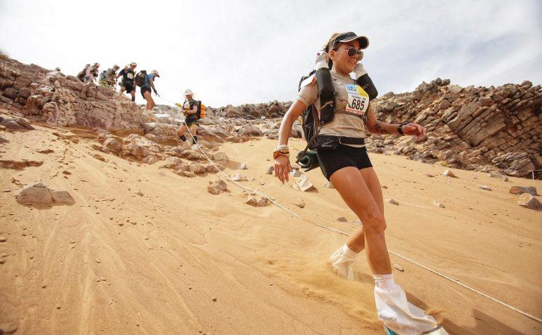 SUSIE CHAN lady running in desert sand