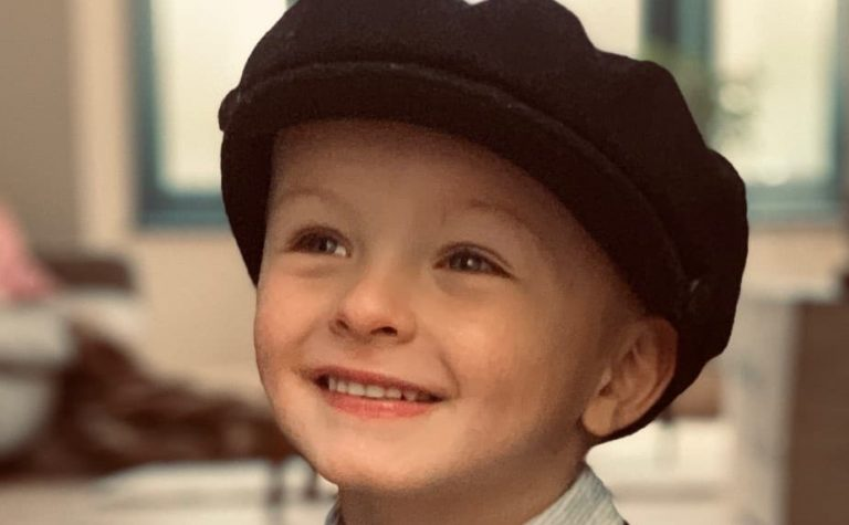 little boy with black beret