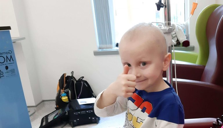 Ceylian boy smiling with thumbs up in hospital