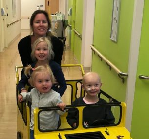 Children in yellow car in hospital