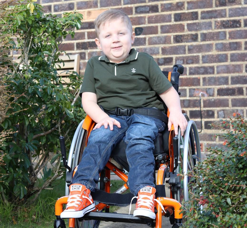 Blake boy sitting in wheelchair