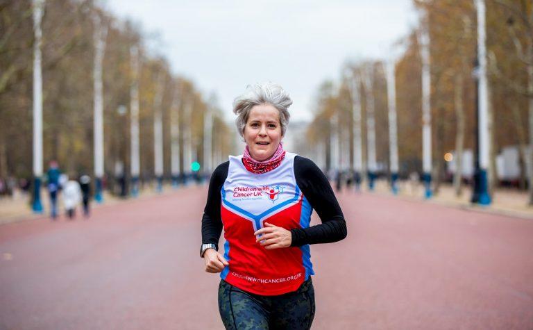 Children with Cancer UK runner, running on her own