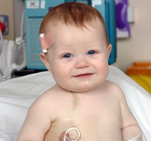 Baby Ted smiling through his treatment in hospital