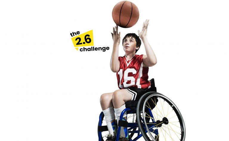 Basketball Wheelchair child with 2 point 6 logo next to him