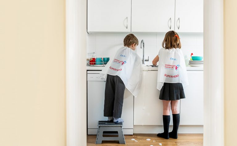 Mini Superheroes kids Washing Up by the sink