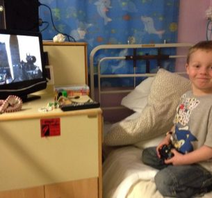 Ollie playing games in hospital