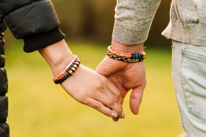couple holding hands wearing notch bracelets