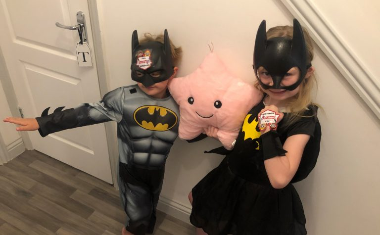 Evie and Tommy dressed as batman and batwoman