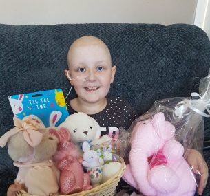 Girl on sofa with gift basket