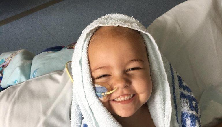 Girl with feeding tube in towel