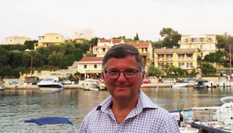 Rod Skinner man looking at camera with the marina behind him