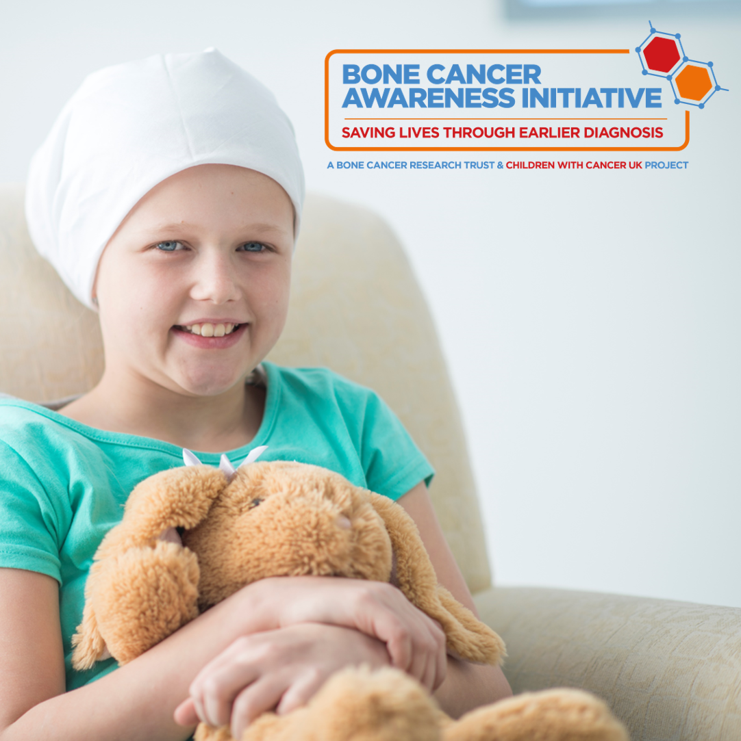girl smiling holding a teddy for bone cancer awareness initiative