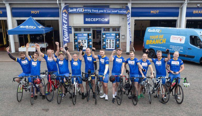 kwik men in a blue on bikes