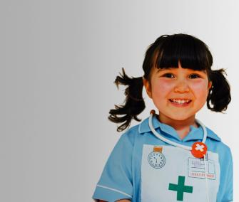 Astrid smilling wearing nurses costume banner