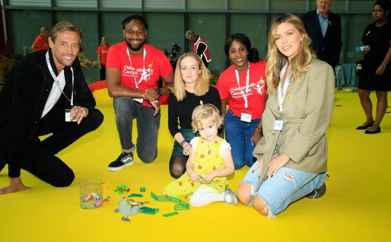 abbey clancy peter crouch at bgc charity day with lily and family