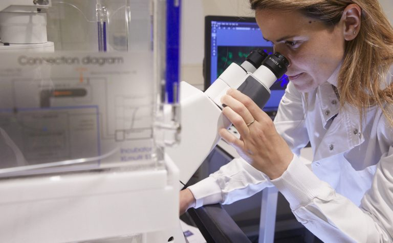 Cancer treatments being tested in a laboratory by a female researcher