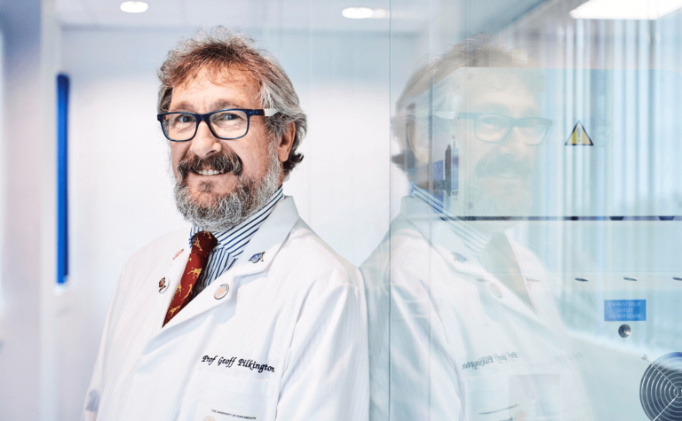 Geoff Pilkington researcher with white lab coat and wearing glasses (1)