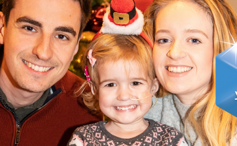 Lily with mum and dad at chrsitmas party and baubles for Gift in Wills