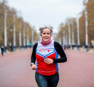 Children with Cancer UK runner running on her own