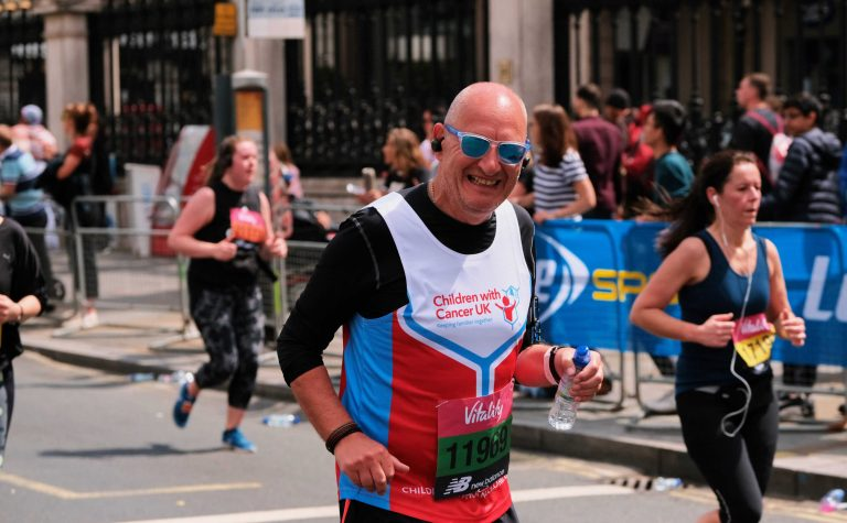 man running in street of london vitality 2019 2